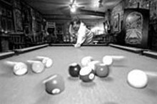 JENNIFER  SILVERBERG - Bars function best when pool balls stay on - the table. Just ask Molly's owner Jeff Brayton.