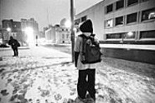 JENNIFER  SILVERBERG - Before the sun rises, Jerad stands outside New Life's - shelter on Locust, waiting for the taxi that takes him to - school.