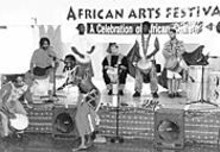 COURTESY OF THE ST. LOUIS PUBLIC LIBRARY - Making some noise at the St. Louis African Arts Festival