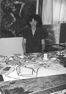 Painter/mixed media artist Christine Ilewski in her Alton studio