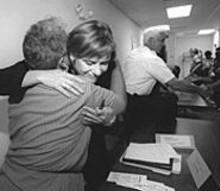JENNIFER  SILVERBERG - Jennifer Joyce hugs Mary Taylor, 3rd Ward Neighborhood Council president.