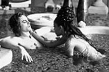 Hell on earth, with a little slice of heaven: Stuart Townsend and the late Aaliyah take a dip in the Damned.