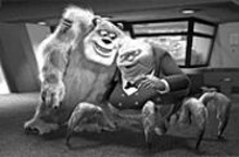 DISNEY/PIXAR - Sully (left), the star Scarer of Monsters, Inc., gets a pat on the back from CEO Henry J. Waternoose.