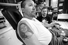 JENNIFER  SILVERBERG - Customer Mike Pagano displays his tattoo of daughter Jamie's face.