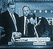"Saying the city is ""open for business,"" Aldermanic President Francis Slay signs the bill as RCGA president Dick Fleming (left) looks on."