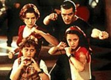Spy Kids (starring, clockwise from top left, Carla Gugino, Antonio Banderas, Alexa Vega and Daryl Sabara) is funny and exciting on enough levels that adults are likely to enjoy it just as much as the rugrats they're forced to chaperone.