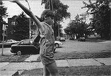 TOM  MADAY - Hanifa Jasarovic, in a photo from After the Fall, turns a cartwheel in front of her South St. Louis home, far from the Balkan nightmare.