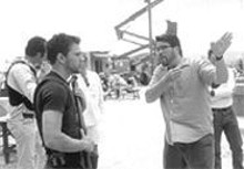 JOHN  BAER - The write man for the job: Chris McQuarrie, right, directs Ryan Phillippe on the set of The Way of the Gun.