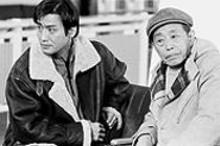 JENNIFER  SILVERBERG - Tony Leung and Xu Zhu between takes of a scene in Gua Sha.