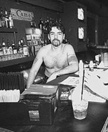 JENNIFER  SILVERBERG - Eric DuFrenne behind the bar at Magnolia's, which has not been bought by SLU.