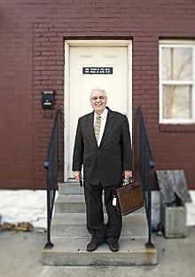 JENNIFER SILVERBERG - William Chignoli on the front steps of Acción Social Comunitaria's clinic on South Grand Boulevard.