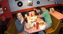 JENNIFER SILVERBERG - After hours: (clockwise from left) Jon Huntley, Ilya Feldman and Daniel Defosset partake of some diner grub.