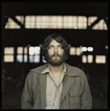 Ray LaMontagne: Darling, dont you go and cut your hair.
