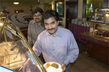 JENNIFER SILVERBERG - Owners Sanseev Reddy Guduru (left) and Niranjan Reddy Seelam (right) take diners on a tour of India from north to south.