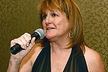 BILL GREENBLATT/UPI - KWMU's general manager, Patty Wente.