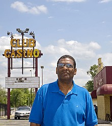 JENNIFER SILVERBERG - Club Casino owner Cedric Taylor stands in front of his nightclub on State Street in East St. Louis.