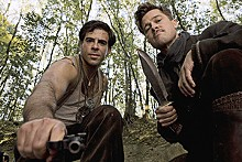 Inglorious Basterds: Eli Roth as Sgt. Donnie Donowitz and Brad Pitt as Lt. Aldo Raine.
