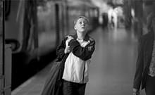 Thomas Turgoose as Tomo arrives in London by high-speed Eurostar train.