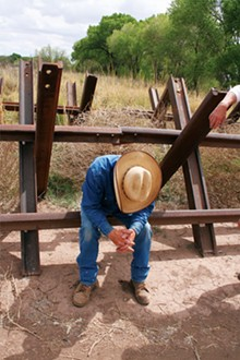 PAUL RUBIN - Cattle rancher John Ladd at the border in Palominas.