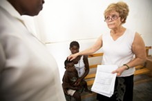 JENNIFER SILVERBERG - Dr. Patricia Wolff and Marie Fleurese Gourges, head nurse at the Justinien clinic, confer over a patient, Robenson Yean. See more photos from Haiti.
