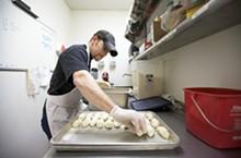 Sanctuaria prep cook Tony Grindel preparing papas rellenas.