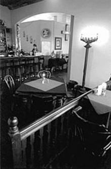 JENNIFER  SILVERBERG - The Maya Café's interior, designed by local artist Bill Christman, is part Latin American, part '60s throwback.