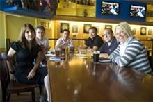 JON GITCHOFF - LouFest organizers Lauren Wojtowicz, Jeff Jarrett, Brian Cohen, Mike Van Hee, Nick Barnes and Natalie Lakeman in their de facto office, the dart room at Blueberry Hill.
