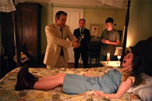 PATTI PERRET - Your mother sews socks that smell: Ashley Bell (front), Patrick Fabian, Louis Herthum, and Caleb Landry Jones in The Last Exorcism.