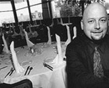 JENNIFER  SILVERBERG - Darin Schmaltz, manager of Carmine's, downtown's newest steakhouse