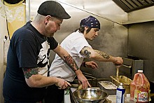 JENNIFER SILVERBERG - Jimmy Hippchen (left) cooks with chef Jaxon Noon.