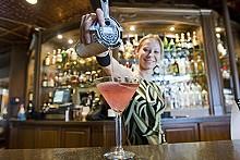 JENNIFER SILVERBERG - Bartender Erin Davis pours a strong one.
