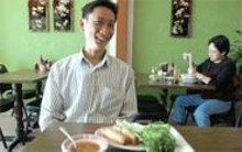 JENNIFER  SILVERBERG - Soup is great food: Pho Long owner Long Kim Hua - (foreground) and regular customer Thuy-Lieu Vo (seated).