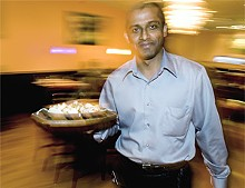 JENNIFER SILVERBERG - Akram Hoque, one of Saffron's three owners, serves traditional Indian fare.