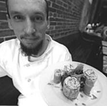 JENNIFER  SILVERBERG - Mangia chef Landis Irwin presents his pleasingly plated stuffed artichokes.
