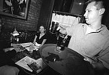 JENNIFER  SILVERBERG - At McGurk's, the service (exemplified here by Casey Kusiak) is attentive to detail and friendly without being overbearing.
