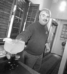 JENNIFER  SILVERBERG - Pueblo Solis head honcho Al Solis offers up one of his famed margaritas.