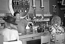 JENNIFER  SILVERBERG - Volunteering for the draught: Bartender Kent Nice - pours a tasty Schlafly brew.