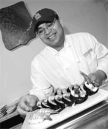 JENNIFER  SILVERBERG - Honor roll: Chef Phong Senethavilay prepares gold-star-worthy sushi.