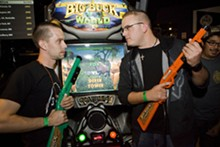 WILLIAM A. RICE - Best frenemies: Derek Tower and Thor Fox, two of the top Big Buck Hunter players in the St. Louis area, face off at the Cubby Bear in Chicago for the Big Buck Safari World Championship Tournament.