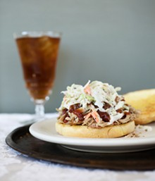 "JENNIFER SILVERBERG - 1.The Barbeque Pulled Pork Sandwich is made with hickory smoked BBQ pork piled on a bun with mam's special barbeque sauce. Here, it is shown ""southern style,"" which means it is served with coleslaw on top. See more photos from Mama Josephine's."