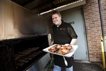 JENNIFER SILVERBERG - PM BBQ co-owner Paul Lamers prepares to toss some meat on the grill.