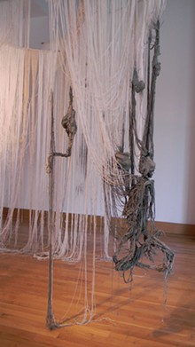 Kristin Fleischmann, A Silkworm of One's Own, string, cement and wood.