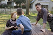 MERIE WALLACE - From left: Jessica Chastain, Tye Sheridan, and Brad Pitt in The Tree of Life.
