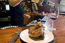 JENNIFER SILVERBERG - Pork out: A one-pound pork porterhouse served over kale, topped with apple compote.