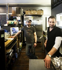 JENNIFER SILVERBERG - Mike Clauser and Brandon Cullum at work in Nora's kitchen.
