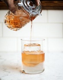 JENNIFER SILVERBERG - A drink on the rock: At Taste, some libations are poured over crystal-clear ice cylinders.