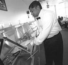JENNIFER  SILVERBERG - Srinivas Katarapu assembles a plate from India Kitchen's lunch buffet.