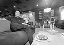 """JENNIFER  SILVERBERG - Just loungin': Manager Thach """"Toc"""" Le of the Drunken Fish kicks back with a So roll"""