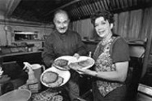 JAY  FRAM - Dreamland Palace owners Mike and Joan Lang with their famous potato pancakes