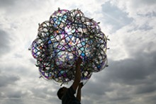 """COURTESY OF THE ARTIST, ANDERSEN'S CONTEMPORARY, TANYA BONAKDAR GALLERY AND PINKSUMMER CONTEMPORARY ART. - Tomás Saraceno, 32SW Iridescent/Flying Garden/Airport City, 2007. Air pillows, elastic rope, webbing, iridescent foil and pump system, 67"""" diameter."""